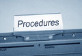 Folder marked procedures gray normally stored in filing cabinet with a plastic label bearing the text x x in black letters on a Stock Images