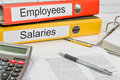 Folders with the labels employees and salaries label Royalty Free Stock Photos