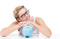Folding arms over a piggy bank happy woman her on white background Royalty Free Stock Photo