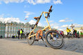 Folding bike Strida on Palace Square of St.Petersburg. Royalty Free Stock Photo