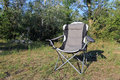 Folding chair on meadow in summer fores Stock Images