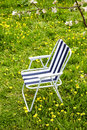 Folding chair under a blossoming tree apple Royalty Free Stock Images