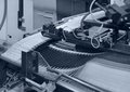 Folding machine detail blue toned of a Royalty Free Stock Images