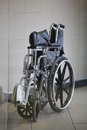 Folding wheelchair in medical hospital Stock Photos