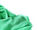 Folds of emerald satin on a white background Royalty Free Stock Photography