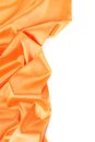 Folds of orange satin on a white background Stock Photography