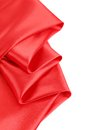 Folds of red satin on a white background Stock Photo