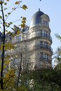 View from Paris park, typical Haussmann round building with slate Royalty Free Stock Photo