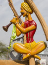 Folk artist statue in surajkund fair playing flute the gate of Royalty Free Stock Photo