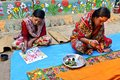 Folk artists an adolescent girl and a woman doing painting bengal patachitra in a small tribal art village in west bengal india Royalty Free Stock Photography