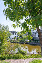 Folk house and lake Royalty Free Stock Photo