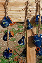 Folk pottery pitchers and ceramic bells hanging with strings on a plank of wood decorations specific for korond area transylvania Stock Photography