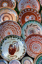 Folk pottery romanian traditional ceramic in the plates form painted with specific reasons horezu area Royalty Free Stock Photography