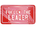 Follow the leader red vanity license plate words a with to symbolize leadership wisdom mentoring and lessons learned to succeed in Stock Photos