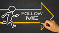 Follow me concept running person and arrow Stock Images
