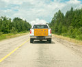 Follow me a pickup truck at the lead of a line of traffic guiding them through a construction zone optional concept of the leader Stock Photos
