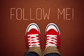 Follow me request concept for social networking on internet with young person in red sneakers from above Royalty Free Stock Images