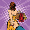 Follow me, young woman leads a man, shopping Royalty Free Stock Photo