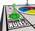 Follow the rules board game piece win challenge compliance proce words on a with moving around to competition by following Stock Images