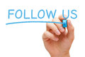 Follow us concept hand writing with blue marker on transparent wipe board Royalty Free Stock Photography