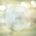 Follow your dreams, Inspirational typographic quote on blur abst Royalty Free Stock Photo