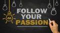 Follow your passion on blackboard background Royalty Free Stock Images