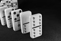 Followers white dominoes in row on textured surface and leader concept Royalty Free Stock Images