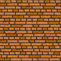 Fond orange sans joint de mur de briques. Image stock