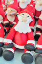 Fondant santas santa clauses made of sitting together used for decorating cakes Stock Image