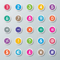 Font numbers to and symbols on colorful paper buttons Stock Images