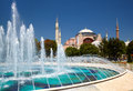 The fontain  in Sultan Ahmet Park with Hagia Sophia in the backg Royalty Free Stock Photo