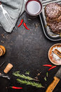 Food background with grilled steak ribeye on grill iron pan on rustic metal background with red wine herbs and spices top view Royalty Free Stock Photography