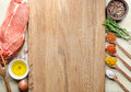 Food background with raw meat steaks and seasoning.