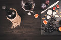 Food background with red wine, figs, grapes and cheese Royalty Free Stock Photo