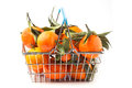 Food basket of tangerines metal full with leaves isolated over white Stock Images