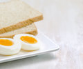 Food boiled egg and toasts on white plate Stock Photo