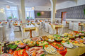 Food buffet platters and dishes of set up for a large catered dinner or lunch Stock Photos