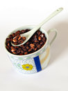 Food cheerful cup with flower and coffee beans inside and teaspoon Royalty Free Stock Image