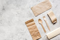 Food delivery workdesk with paper bags and flatware table background top view mock-up Royalty Free Stock Photo