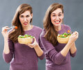 Food and diet confusion with displeased or thrilled young woman Royalty Free Stock Photo