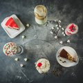 Food frame with milkshake drinks and desserts. Milkshakes and cake. Flat lay