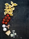 Food frame. Pasta ingredients. Cherry-tomatoes Royalty Free Stock Photo