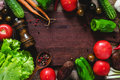 Food frame: summer vegetables on wooden cutting board Royalty Free Stock Photo