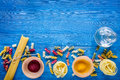 Food ingredients for Italian pasta on blue wooden desk background top view copyspace