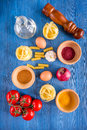 Food ingredients for Italian pasta on blue wooden desk background top view