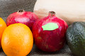Food labeling concept fresh fruits and vegetables for a of gmo vrs organic foods Royalty Free Stock Image