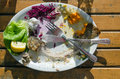 Food leftovers of trout beet corn on a plate on a wooden table Royalty Free Stock Images