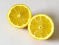 Food lemon cut in two in the foreground Royalty Free Stock Image