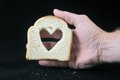 Food and love bread with heart on a darck background Royalty Free Stock Photos