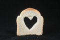 Food and love bread with heart on a darck background Stock Image